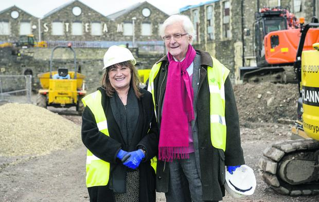 This Is Wiltshire: Lord Kenneth Baker visiting the site of the new UTC, where he was taken on a tour by the college's principal, Angela Barker-Dench