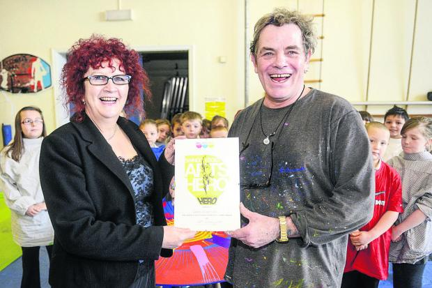 This Is Wiltshire: Gordon Dickinson receives his Community Arts Award from Josie Williams. Picture: Alex Skennerton