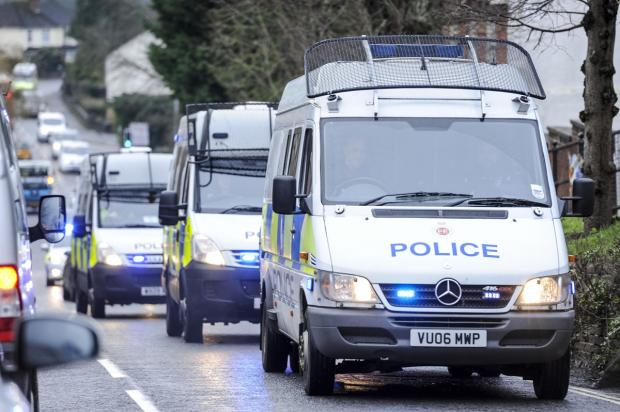 This Is Wiltshire: A police convoy rolls out ahead of today's drugs raids
