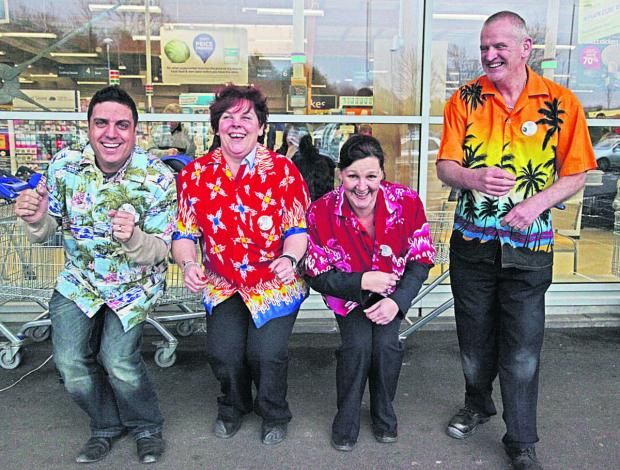 This Is Wiltshire: Tesco staff demonstrate the Cha Cha Slide to Marlborough shoppers