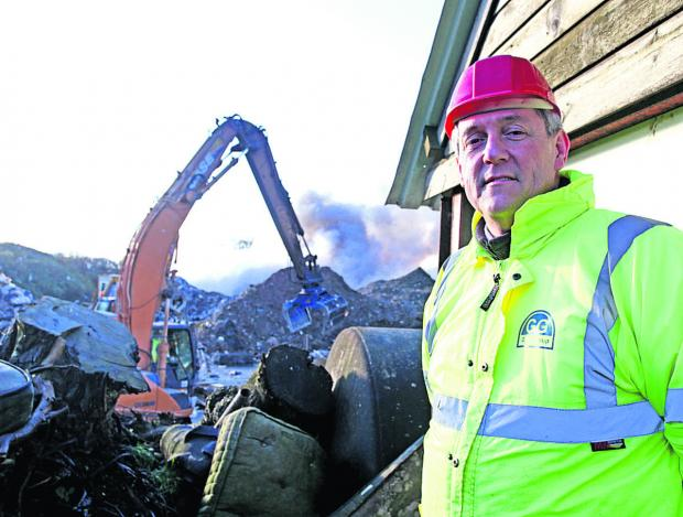 This Is Wiltshire: Paul Mortimer, operations manager at Wiltshire Waste (Recycling), is surprised the fire is still smouldering