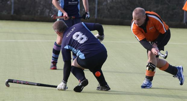 This Is Wiltshire: Mark Tolley, left, in action for Wootton Bassett at the weekend