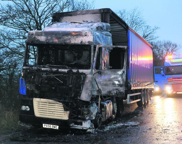 This Is Wiltshire: The lorry which caught fire at the lay-by near Seend fork this morning