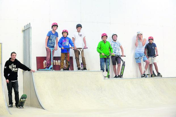 This Is Wiltshire: Skateboarders at the opening of Malmesbury skate park last year.