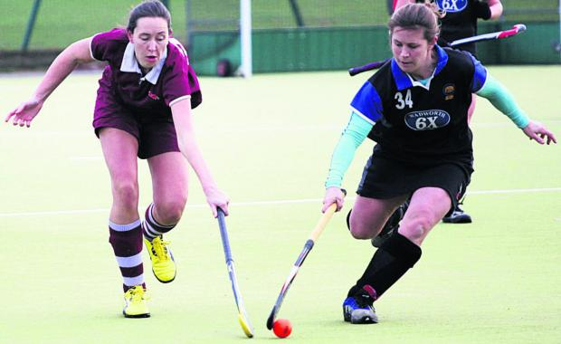 This Is Wiltshire: Devizes' Jennie Holloway (right) battles with Melksham's Laura Mizen during the sides' Wessex Division One clash that leaders Devizes won 2-0
