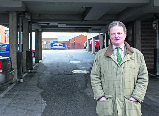 This Is Wiltshire: Coun Simon Jacobs in the trouble-plagued car park beneath Stanford Court