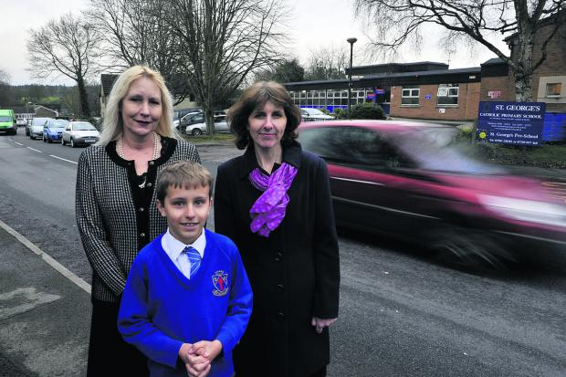This Is Wiltshire: Headteacher of St George's, Louise Croker, left, with Rachael Cox and her son Josh who are campaigning for a zebra crossing outside the school