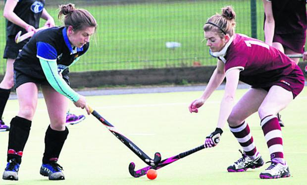 This Is Wiltshire: Jennie Holloway and Melksham Ladies' Katherine Robinson (right) battles with Devizes' Jennie Holloway during Saturday's West Clubs League Wessex Division One clash that Devizes won 2-0