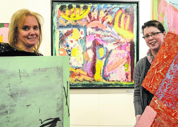 This Is Wiltshire: Museum marketing manager Nicki Western, left, and curator Sophie Cummings with works going on display. Picture: Alex Skennerton