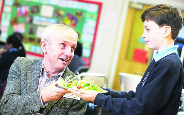 This Is Wiltshire: Patrick serving a salad to Oliver Dowding  Picture: THOMAS KELSEY