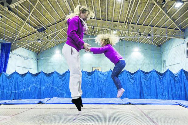This Is Wiltshire: Izzie Moore and coach Lucy Ingram at Stratton Leisure Centre, which has almost completed its £1m refurbishment. Picture: Alex Skennerton