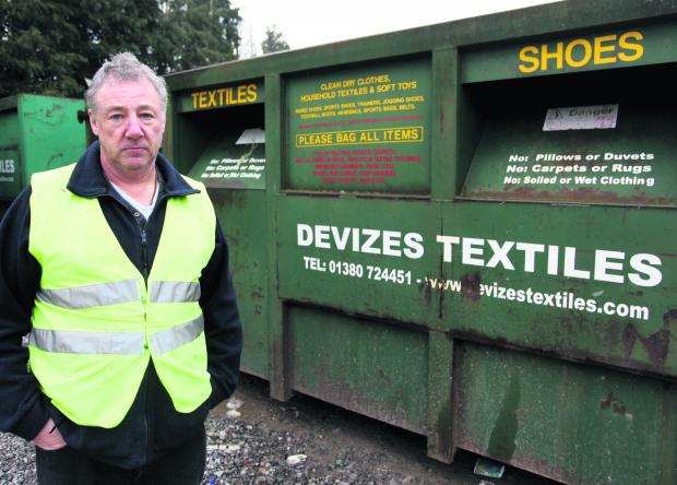This Is Wiltshire: Danny Williamson, contracts manager at Devizes Textiles, with the sort of clothing banks that were stolen