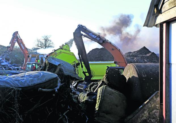 This Is Wiltshire: Smoke rise from the Wiltshire Waste (Recycling) Ltd depot yesterday