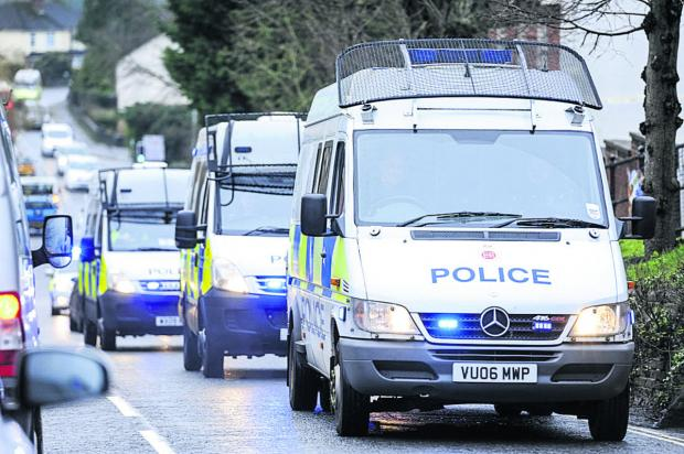 This Is Wiltshire: Part of the winding convoy of police vehicles on the way to the Operation Harness raid
