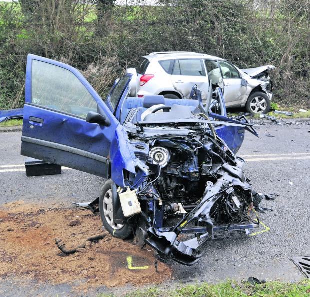 This Is Wiltshire: A woman was trapped after this accident on Sandridge Hill this morning