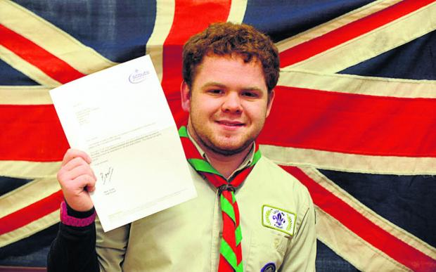 This Is Wiltshire: Joe Pearson, with the letter he received from Chief Scout Bear Grylls. He has been awarded the Cornwell badge for dedication to Scouting and courage