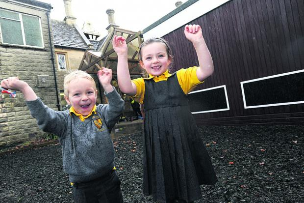 This Is Wiltshire: Pupils Oliver and Emily are happy the clock tower, inset, will be fixed