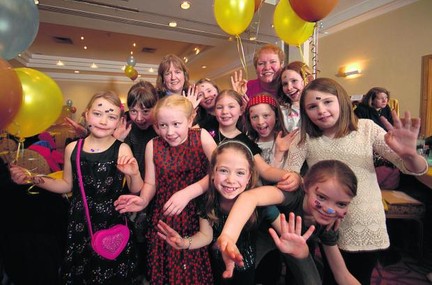 This Is Wiltshire: Members of the 1st Minety Brownies enjoy the centenary party. Picture by Russell Sach
