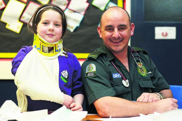 This Is Wiltshire: A pupil  from Ruskin Junior School tries out hospital dressings with Steve Tanner