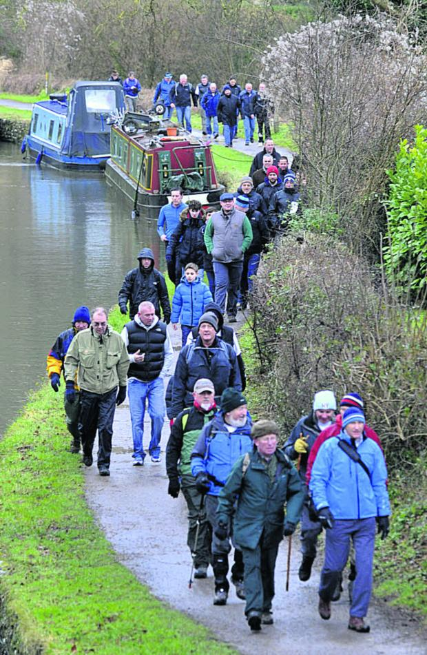 This Is Wiltshire: The walkers make their way along the Kennet & Avon Canal