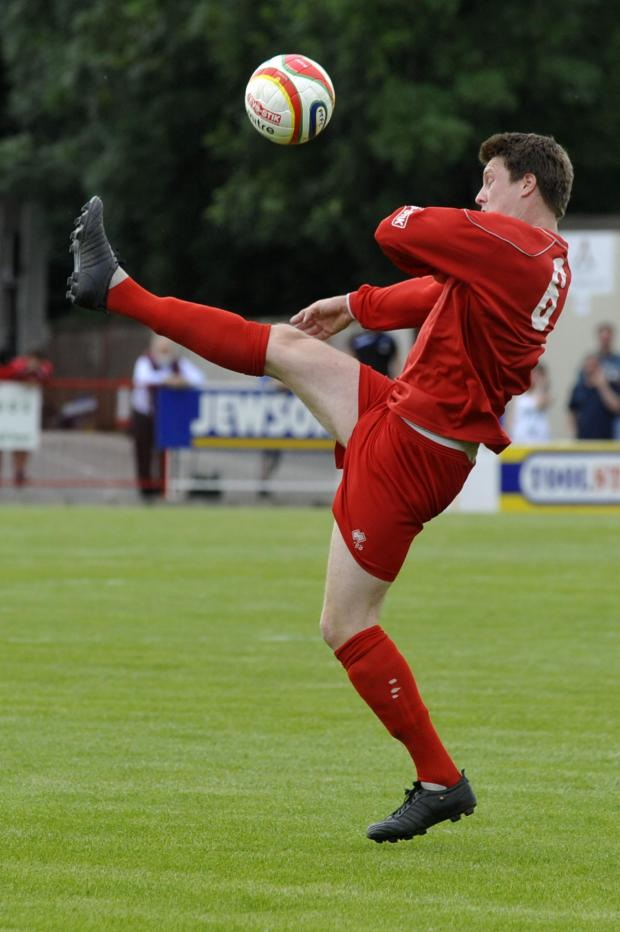 This Is Wiltshire: Alex Lapham, pictured playing for Frome Town, was on target for Warminster Town last weekend