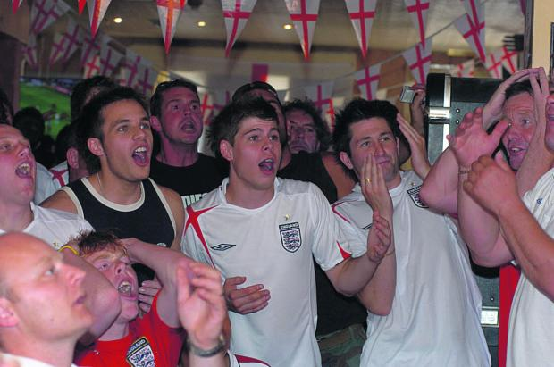 This Is Wiltshire: Fans watching an England game at the Dolphin pub in Rodbourne