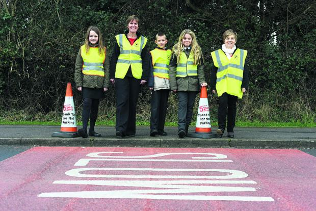 This Is Wiltshire: Haydonleigh school have been set aside funds to put a safety zone around the school. Pictured Hattie, Head teacher Frances Billing, Jacob, Eve and Debbie Yockney