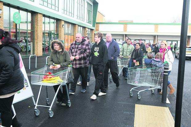 This Is Wiltshire: There's a queue of shoppers for the opening of Morrisons' Dorcan Way store in Eldene
