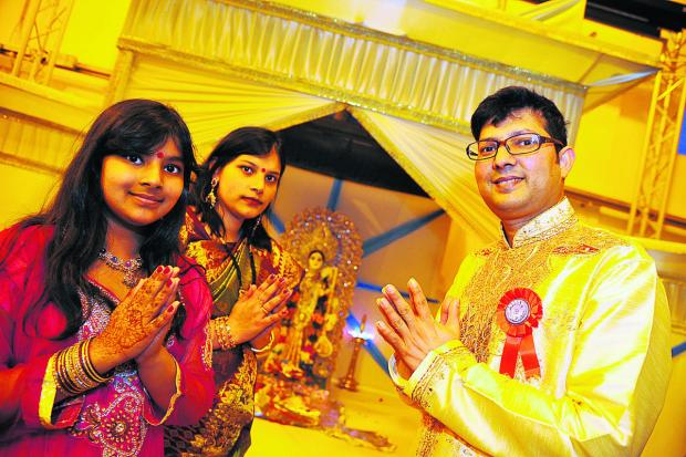 This Is Wiltshire: From left, Suzana, Kakoli and Sujan Saha, celebrating at the puja