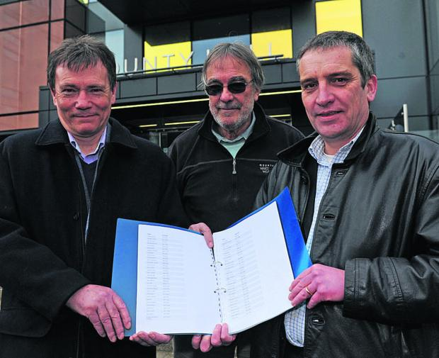 This Is Wiltshire: Campaigners Paul Gaunt, Mike White and Allan Stellard with the petition against the rise in allowances for Wiltshire councillors