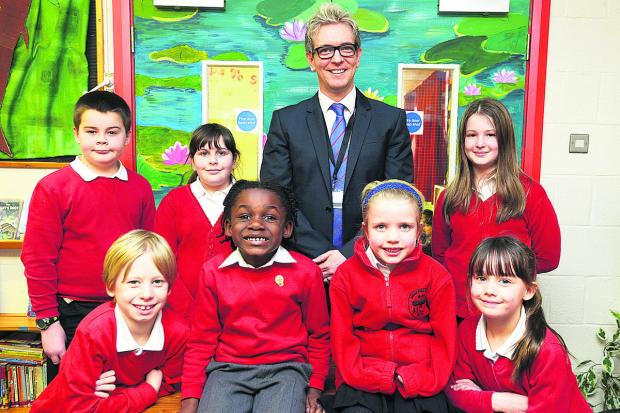 This Is Wiltshire: Headteacher  Dan Clarke  with pupils at Brook Field School