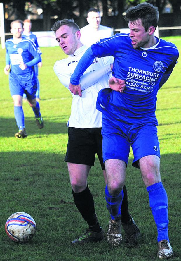 This Is Wiltshire: Calne's Tom Boakes (white) battles with Chippenham Park's Phil Baker during Saturday's derby