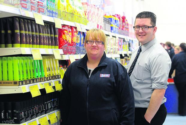This Is Wiltshire: Kate Harrington with B&M interim store manager Mike Hedley