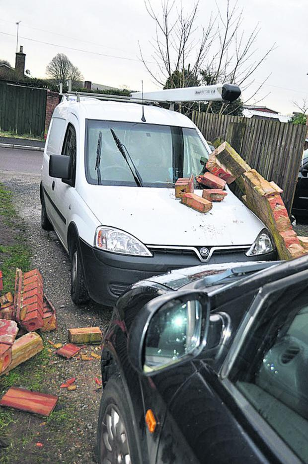 This Is Wiltshire: The damaged van and car in Woodcock Road, Warminster