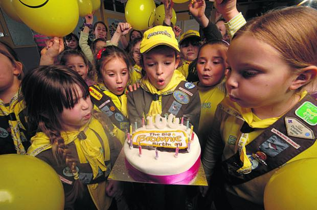 This Is Wiltshire: Melksham Brownies enjoy their birthday cake Photo: Russell Sachs