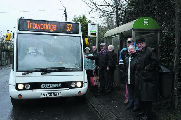 This Is Wiltshire: North Bradley parish councillor Horace Prickett, right, with villagers catching the new 67 bus at North Bradley