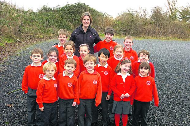 This Is Wiltshire: Head of governors Sam Wolcough with children at the new play site