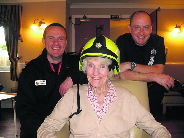 This Is Wiltshire: Firefighters meet Ferfoot Care Home residents