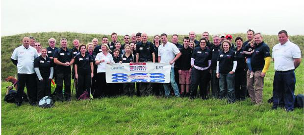 This Is Wiltshire: Tim Shapland, front row centre in dark shirt, with fellow Longstrider volunteers who have helped him raise over £20,000 for the Combat Stress charity