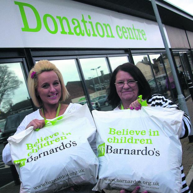 This Is Wiltshire: Sales assistant Sabrina Millar and volunteer Sue Doig are encouraging donations