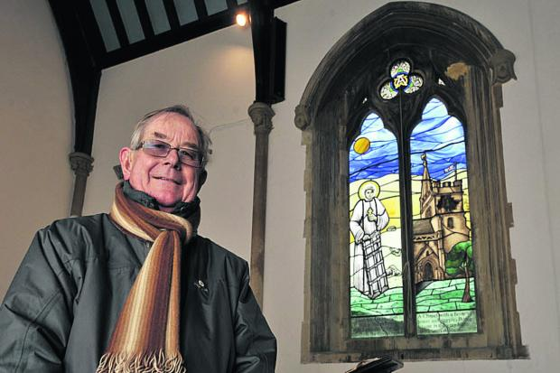 This Is Wiltshire: David Frostick, feoffee of St Lawrence Chapel, Warminster, with the new stained glass window Photo: Glenn Phillips (48098)