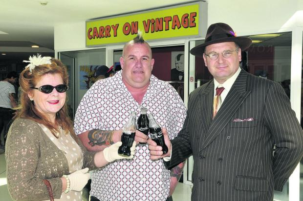 This Is Wiltshire: Erica Fowers, Steve Stuart and Cliff Fowers at the opening of Carry On Vintage, which was a pop-up shop in the town