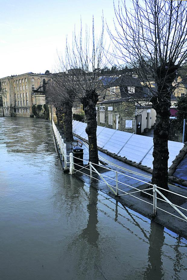 This Is Wiltshire: Temporary flood barriers in place at The Bullpit, Bradford on Avon, this morning