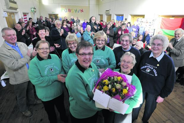 This Is Wiltshire: Operation Christmas Child's Hilary McFall, centre left, says farewell to colleagues at Melksham Baptist Church on Saturday                                                                           Photo: Glenn Phillips (48101)