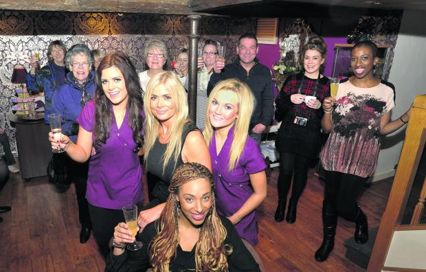 This Is Wiltshire: Courtney Wicheard, front,  Tracey Tyler, Danielle Tyler, left, and Leanna Clarke, front  right, of The Beauty Spot with family, friends and customers at their launch  party on Saturday                                                  Photo: Glenn Phillips