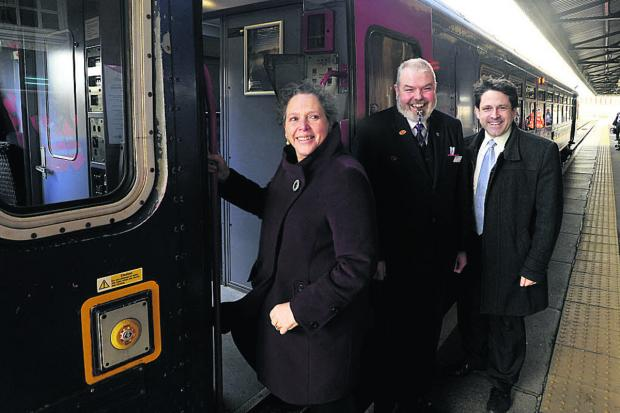 This Is Wiltshire: Baroness Kramer boards the train at Westbury, alongside train guard Simon Loftus and Chippenham Constituency MP Duncan Hames
