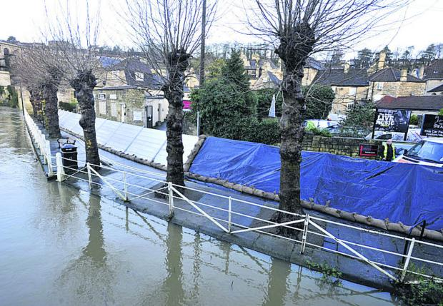 This Is Wiltshire: Temporary flood barriers in place at the Bull Pit, Bradford on Avon, today
