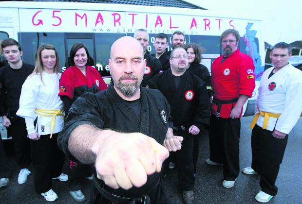 This Is Wiltshire: Master instructor Ken Stronach, with members of the G5 Martial arts group