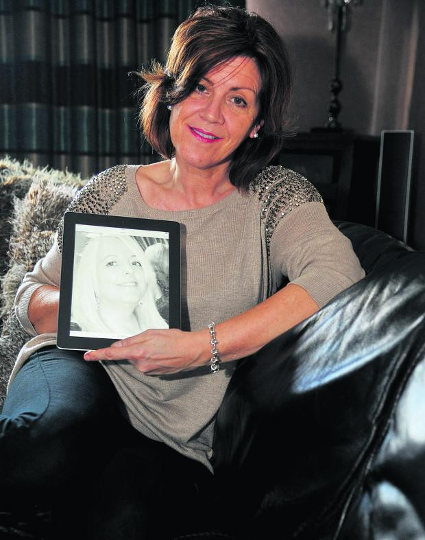 This Is Wiltshire: Lynzi Barrett with a picture of her late friend Karen Lloyd