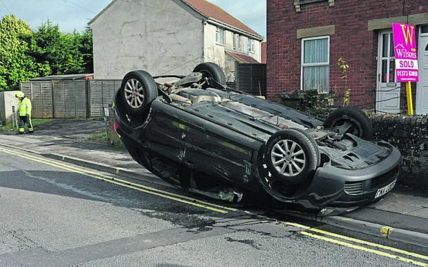 This Is Wiltshire: The car on its roof in Westbury